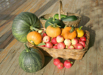 Apples and pumpkins in a basket