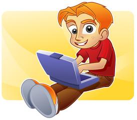 Happy teenage boy blogging