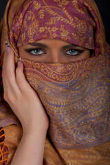 Muslim girl with beautiful blue eyes