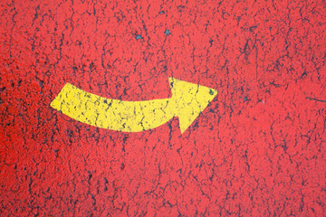 Yellow arrow in the red background