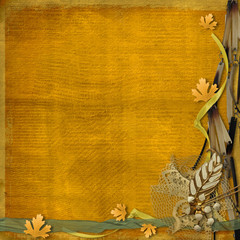Old grunge paper on the abstract background with autumn leaves
