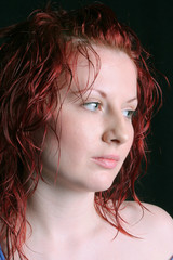 beautiful young woman with nice skin and red hair