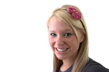 Beautiful sweet young woman smiling with a flower headband