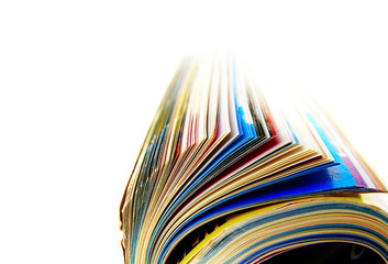Closeup of a rolled up magazine, on white
