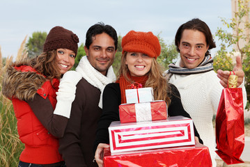 friends with christmas gifts or presents