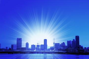 高層ビルと太陽