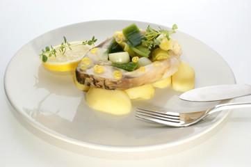 carp fillet on organic potato and lemon