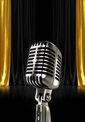 Vintage microphone in theatre with curtain