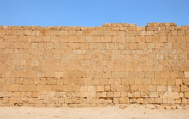 Ancient yellow stone wall texture