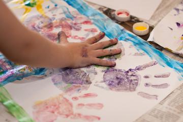 Little Children Hands doing Fingerpainting
