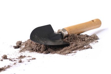 Little spade shovel isolated over a white background.