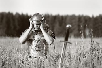 One Roman soldier in field.