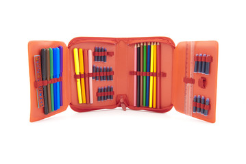 Red case with a set of tip pens and pencils for the schoolboy