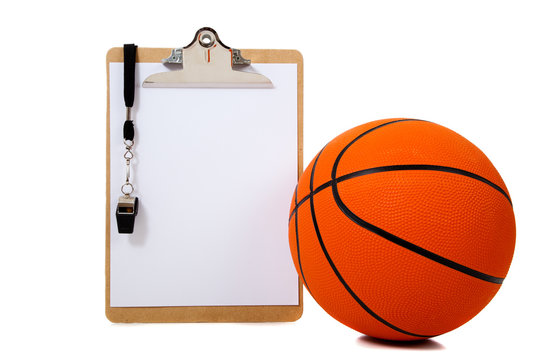 Basketball and clipboard on white