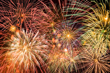 Lots of colorful fireworks exploiting simultaneously