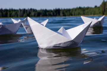 origami paper boats in lake