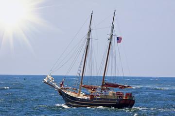 Sailboat sailing  at the sunny day