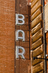 Derelict bar sign in Rome, Italy