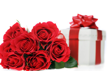 beautiful red roses and present