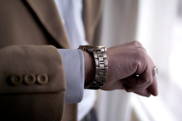 close up shot of a businessman looking at his watch