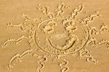 soleil déssiné sur la plage