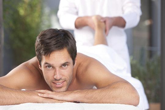 Healthy man relaxing at spa
