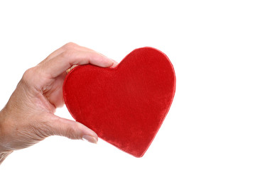 elderly  woman hand holding red heart