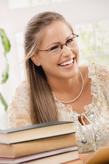 Happy student girl reading book