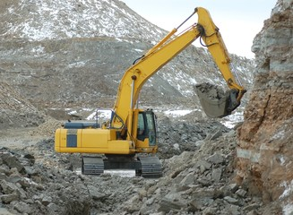 Digger in open cast mining quarry