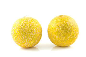 two fresh yellow melon  over white background