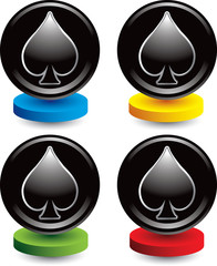 Spade playing card suit on colored discs