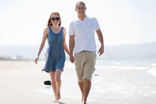 love couple walk on the beach
