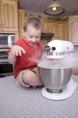 Boy and flour in mixer