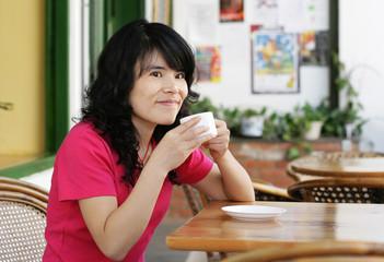 woman enjoying a relaxing cup of coffee