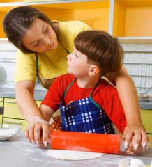 Woman and the boy on kitchen