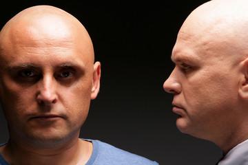 Two bald men