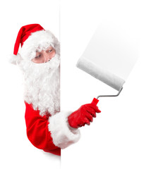 santa claus painting an advertising sign with a roller