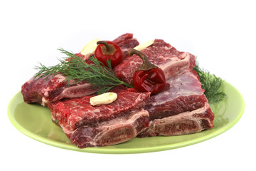 uncooked ribs on green dish