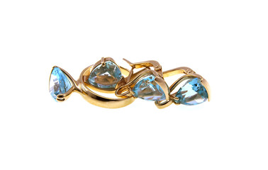 Gold earrings and a ring with a dark blue topaz