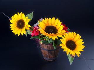 sunflowers bouquet on black