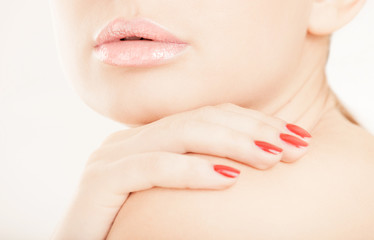 Woman lips and hand close-up