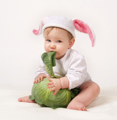 Baby with cabbage