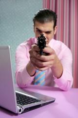 Businessman point his handgun to camera