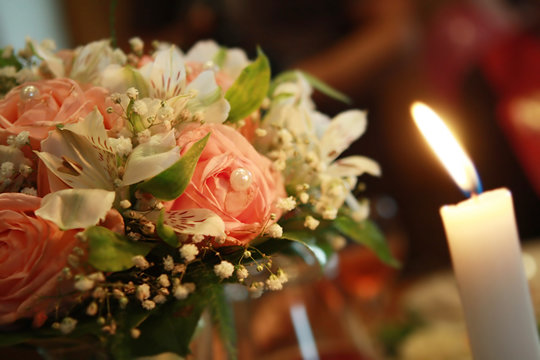Wedding flowers and candle