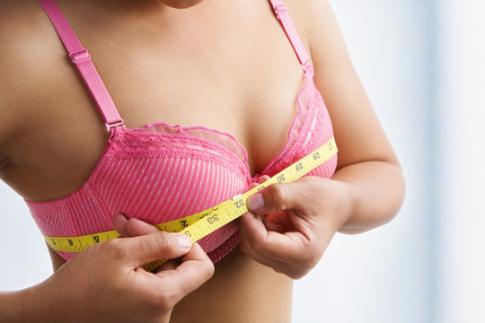 Woman measuring breast size