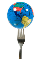 Small globe on a fork (isolated on white)