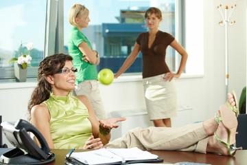 Businesswoman throwing apple