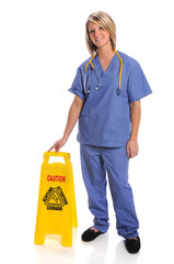 Health Care Worker With Safety Sign
