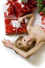 Santa girl lying under the tree
