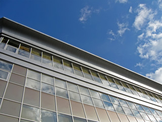 new urban glass reflective building, blue sky